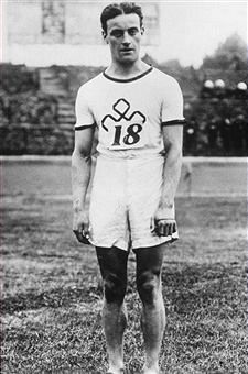 black and white photograph of white male athlete from 1913